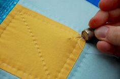 Now that you've tried your hand at piecing a quilt block with CRAFT's Quilting 101 post, learn how to stitch like a pro with this wonderful hand quilting