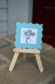 Saw an adorable popsicle stick easel pin, but couldn't find the actual tutorial... I then found this one, and it includes really cute ideas to display on your easel. (And a link to a tutorial for home made water colors!)