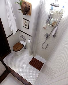All-in-one awesomeThe shower is incorporated right into the greater overall space in this diminutive bathroom. White 1x1 inch tile is used o...