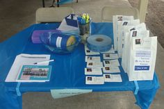 Registration Table. Name Tags, Survival Bags, Memory Book and Order Form, Raffle Tickets, and List of Names.
