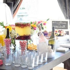 Pin for Later: The Place You Haven't Thought to Look For Affordable Wedding Decor Refreshment Station Striped straws, a glass beverage dispenser, and fun glassware are all entertaining finds from HomeGoods that are fit for the day you get hitched.
