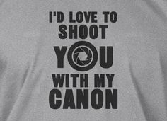 Gifts for Photographers Camera Photography Shoot You With My Canon Tshirt T-Shirt Tee Shirt Mens Womens Ladies Youth Kids. $14.99, via Etsy.