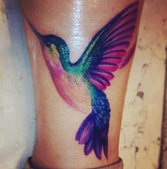 Pretty and Colourful Hummingbird Tattoo.