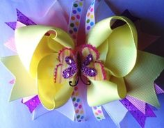 """6"""" Purple and Yellow Stacked Layered Spiked Glittery Butterfly Hair Bow, Adorable, Sparkly, Toddler, Girls, Over The Top, OTT, Fun, Funky by GirlyCurlBowtique on Etsy https://www.etsy.com/listing/248390097/6-purple-and-yellow-stacked-layered"""
