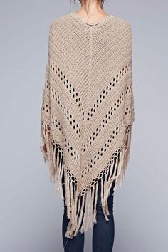 This bohemian inspired crochet poncho has a long tassel tie in front and long fringed hemline. Ultra soft cotton/acrylic blend yarn in a soft, neutral tone to compliment your spring and summer outfits