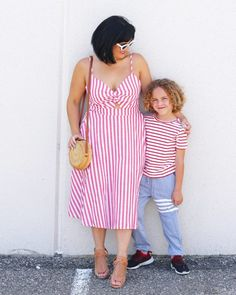 b5970cf968 Red and white stripes with a dress, earrings, round straw bag, striped tee
