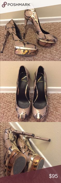 Brian Atwood Pumps Metallic snakeskin 4 inch heels.  Brown/bronze/gold.  Worn 2 times.  No- slip sticker I put on bottom can be removed.  Size says 8/38.5.  I am usually an 8/ 8 1/2.  Love them! Brian Atwood Shoes Heels