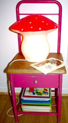 LOVE the pink chair with the drawer. Really love. And I very much want a toadstool lamp for my little girls' bedroom.