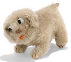 A STEIFF MOHAIR PIP, (6312,0), standing, brown tipped, black and white googlie eyes, brown stitching, orange felt tongue, swivel head, inoperative squeaker and FF button with red cloth tag, circa 1928 --6in. (15cm.) long (faded and slight thining)