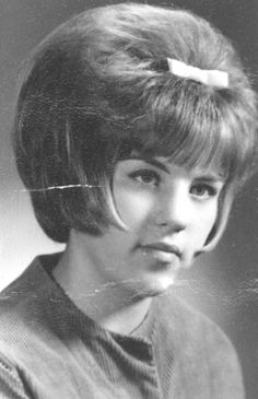 1960s.  It was the era where grown women would wear bows, ribbons and little barrettes in their hair.  Also, pigtails.  The Little Girl look was en vogue.