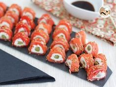 A fancy appetizer, reminding of sushi rolls, perfect for a great dinner party ! - Recipe Appetizer : Salmon rolls with goat cheese - video recipe ! by PetitChef_Official Mini Aperitivos, Fancy Appetizers, Appetizer Recipes, Cooking Chinese Food, Quick Side Dishes, Tapenade, Goat Cheese, Feta, Food Videos