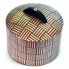 John Walter Carnes...Marriage of Metals lidded container... silver, copper, ebony, white brass