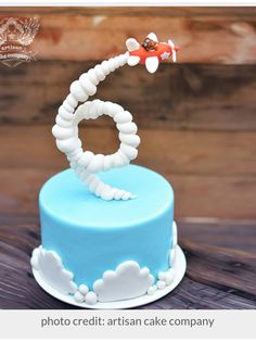 Gravity Defying Airplane Cake Tutorial Gravity Defying Airplane Cake Tutorial (for purchase from Artisan Cake Company) - it's cool how the plane's trail looks like a 6 Crazy Cakes, Fancy Cakes, Fondant Cakes, Cupcake Cakes, Fondant Cake Tutorial, Kid Cakes, 6 Cake, Number Birthday Cakes, Cake Birthday