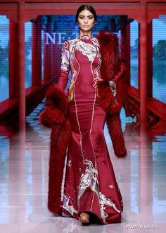 Models present creations by NE TIGER Haute Couture 2015 collection with the theme 'Qipao' during the opening show for the China Fashion Week in Beijing, capital of China, Oct. 25, 2015.