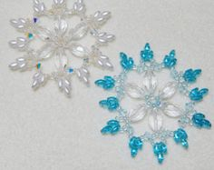 Snowflakes work great for your Christmas Tree or they can be made into pendants by dipping them into floor wax. I use the SC Johnson Pledge with Future shine. When dipping your snowflake just put a small amount of the floor wax into a dish and dip then dab with a paper towel and place on a sheet of wax paper to dry. The beads keep the shine and your snowflake is ready for the tree or to wear. When using as a pendant be sure not to get it wet or the wax will become tacky.    Supplies for this…
