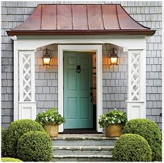 Cottage Charm -- Make a Statement at the Entry - A bluestone stoop w/ a swooped copper roof, white lattice columns, a front door w/ a punch of color add prominence to the cottage's entrance. Front Door Awning, Teal Front Doors, Front Stoop, Front Door Colors, Aqua Door, Front Entry, Porch Awning, Door Overhang, Porch Canopy