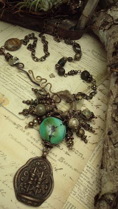 Tantra  Mixed Media Necklace Amulet by AlteredAlchemy on Etsy, $82.00