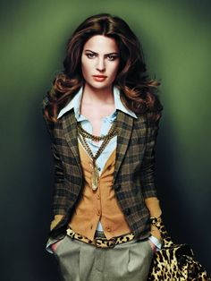 I love everything about this look: the hair, the jacket, the cardigan, the leopard print, swoon!