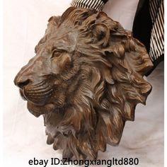 lion head statue - Google Search