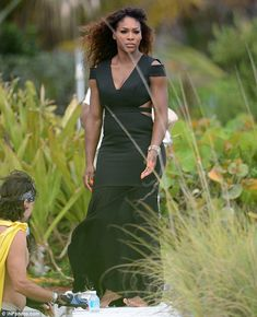 Shoeless: Serena soon slipped off her trainers to suit the classy dress