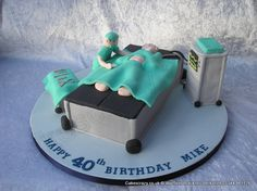 Operating Theatre Cake. Novelty shaped cake with a modelled surgeon in the operating theatre about ready to made the incision