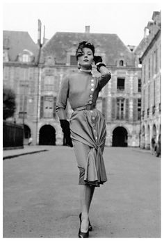 Bettina Graziani wearing an afternoon dress by Jacques Fath. Place de Vosges, Paris, 1950. Photo: Willy Maywald.