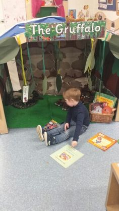 Thomas enjoying the Gruffalo arch reading and role play area for early years