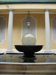 WATER FOUNTAIN with Water Lilies is focal point of the garden colonnade. RS McDANNELL