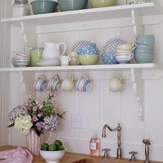 """You don't have to buy a bulky china cabinet to house cups and saucers."" Cute faucet, too!  Photo by Deborah Whitlaw Llewellyn."