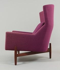 """Jens Risom Design Lounge Chair  Designed in 1960, this big lounge chair has a triangular walnut base, tapering legs, plum woven wool textile covering. Apprx. 41-1/2""""H x 37""""W x 33""""D, loose seat and back cushions. One of the first designers to bring the traditional Scandinavian values of function and craftsmanship to the United States, Risom was part of a new vanguard that helped establish post-war America's leadership role in the world of modern furniture design and manufacturing."""
