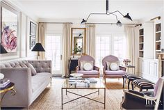 Touches of Purple in lounge with mauve in the wall behind book case to highlight accents