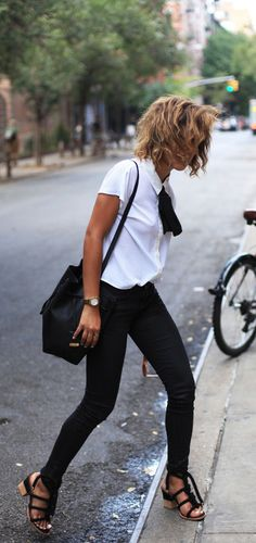 Christina Caradona is wearing a white top and jeans from Buffalo, bag from Kenneth Cole, shoes from Stories and sunglasses from Elizabeth & James