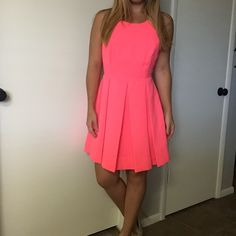 """Hot Pink Skater Dress Gorgeous dress! It features a pleated skirt that is slightly lower in the back. Rear hidden zipper on the skirt and gold zipper at the upper back with a beautiful cut out design. 100% polyester. It says it's a size small, I'm 5'1"""", 120 lbs, 34B bust, 27"""" waist and it is slightly big on me. Dresses"""