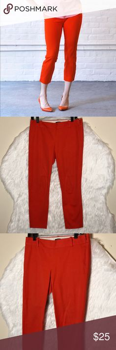 """J.Crew Red Orange Cropped Ankle Pants It's called the """"magic pant"""" around the office for a reason: It's sleek, chic and slim fitting, with an exactly-right-length leg. And it goes with just about everything. It has tiny spot but it will remove when wash it. inseqm: 25"""", rise: 8.5"""". laid flat across @ waist: 15"""".. NWOT J. Crew Pants Ankle & Cropped"""