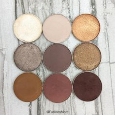 Makeup Geek Eyeshadows in Rapunzel and Baby Face (top row) Moondust, Brownie Points, and Pretentious (middle row) Tiki Hut, Wild West, and Americano (bottom row).
