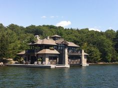 I came across this stunning boathouse on Lake Joe. I love the wood stain color and the stone. Also a genius addition is the infinity edge hot tub at the end of the dock. So smart!