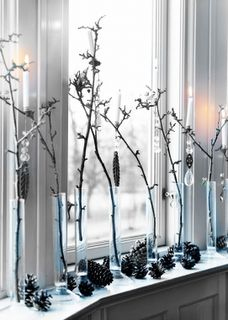 I love the idea of putting random branches in long skinny vases as an alternative to a flower display.