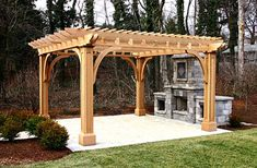 Outdoor Kitchen Pergola - This patio pergola, along with a very attractive outdoor kitchen, establishes an open-air room. Large paneled posts, with substantial beams and brackets, echo details of the home. #pergoladesigns