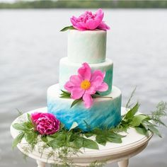 This blue ombre cake with pops of pink has us wishing for a nibble. Xoxo @weddingchicks PC: Lisa Kwan Images #cake #wedding #blue #lake #somelikeithaute #instafollow