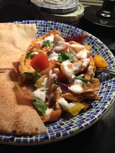 "Oven roasted chicken shawarma with heirloom cherry tomatoes and some homemade ""raita"" (made with greek yogurt"""