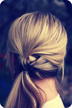 Tie it in a knot, leaving a top section up to cover the hole. Gotta love the easy hairstyles that look complicated!