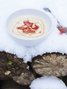 Hot porridge with warm rhubarb compote and toasted almonds