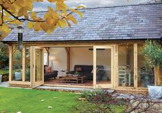 Garden room architecture Oak garden room with glazed gable and bi-folding doors Garden Room Extensions, House Extensions, Orangerie Extension, Oak Framed Extensions, Conservatory Kitchen, Border Oak, Cottage Extension, Oak Framed Buildings, Oak Frame House