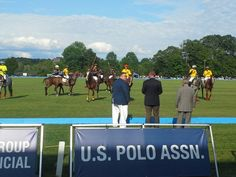 Players and horses on the field.