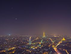 Paris by night (triple conjuntion of Venus (top), Jupiter, and a young crescent Moon)