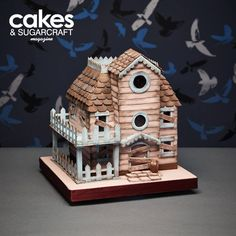 Haunted house cake tutorial by Karen Taylor for the Autumn 2014 issue of Cakes & Sugarcraft magazine. It even has a hollow roof section for sweets!