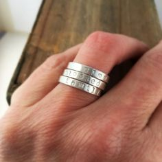 Three custom Sterling silver hand stamped stacking family name rings by JustJaynes