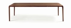 A table with an elegant, sinuous design. The legs are in solid wood, reinforced with an internal metal structure and joined to the top by means of a special system of dove-tail joints. Available in all the range's wood types.
