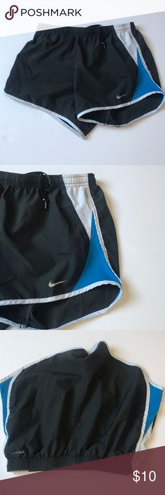 Nike shorts Blue and grey Nike running shorts with white detail. Perfect for casual days or working out. Gently used, but in perfect condition. Nike Shorts