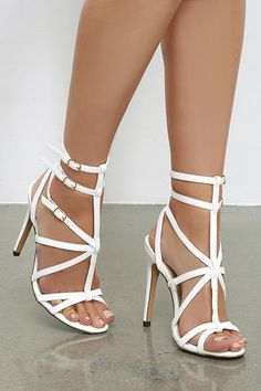 Weren't you just saying how much you need a pair of sexy dress sandals? Well, the Bound to Appear White Caged Heels have got you covered! A strappy vegan leather upper includes three adjustable ankle straps with gold buckles.